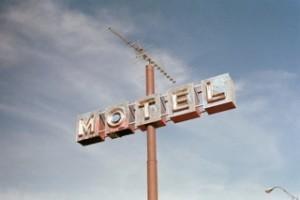 Cartel de un motel de carretera para el artículo de la infidelidad